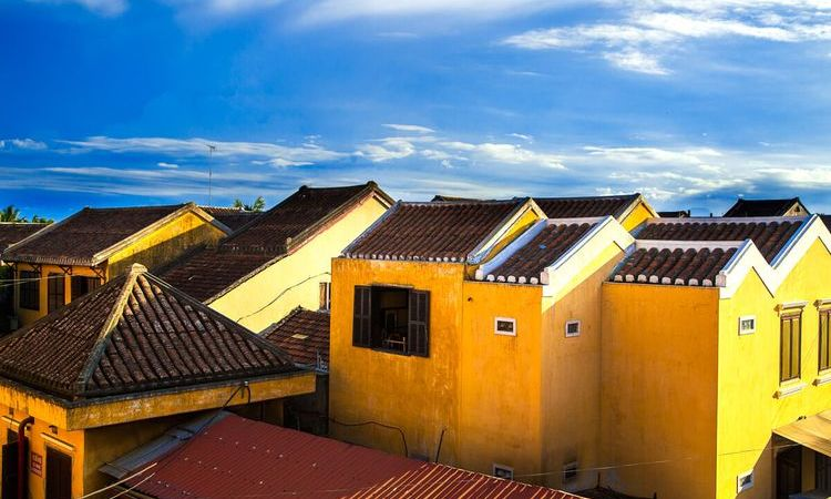 Why are houses in Vietnam painted yellow?