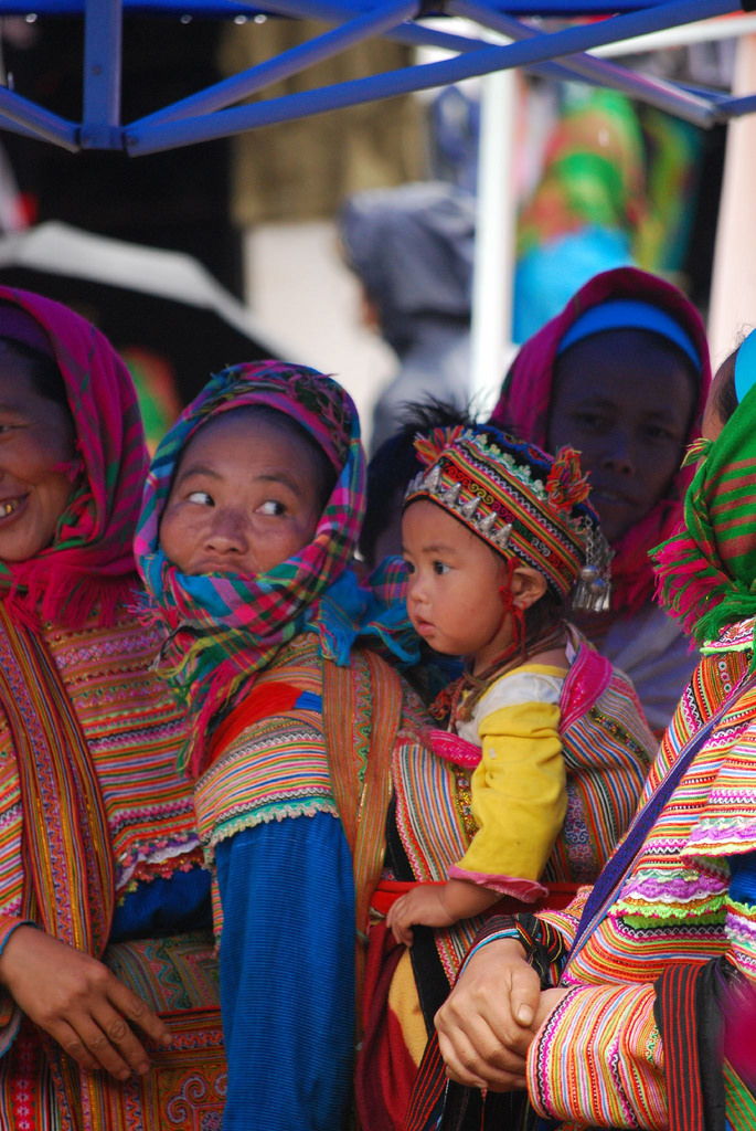 The-children-are-led-by-parents-to-buy-new-clothes-hmong-market