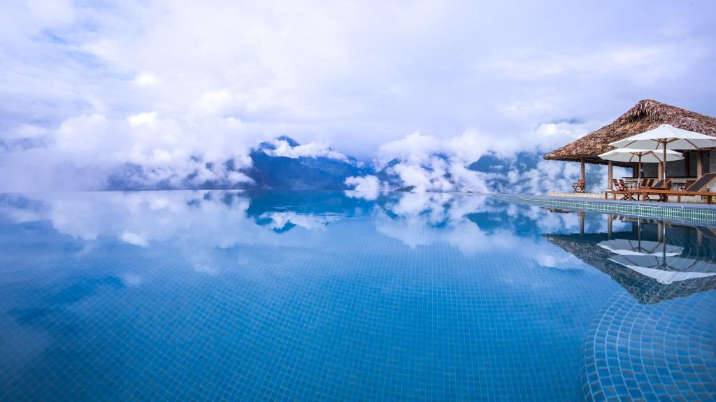 The infinity pool is surrounded by incredible views of peaks, clouds and valleys