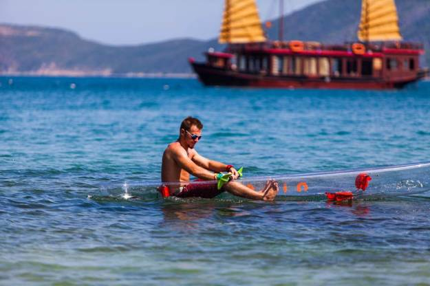 Transparent sea kayaking - one of interesting activities of Emperor Cruises