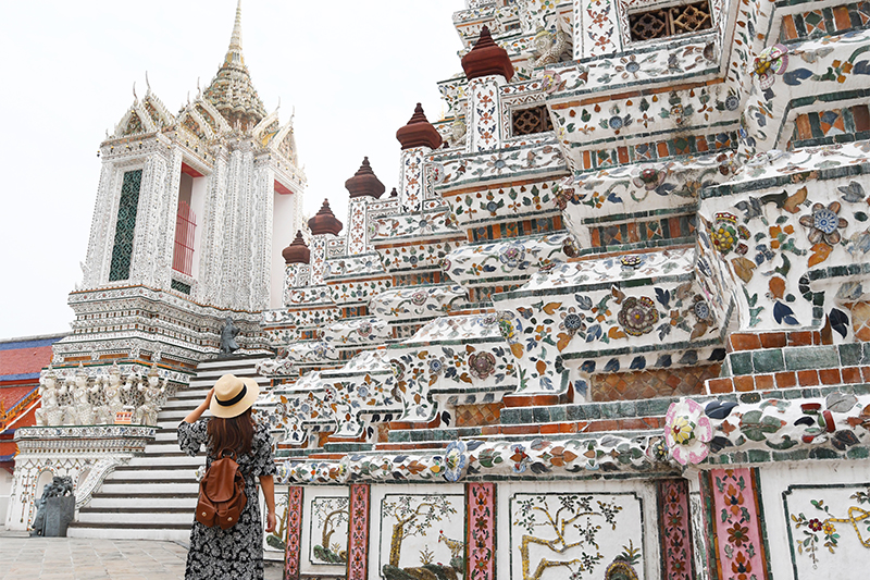 Woman-tourist-is-traveling-and-sightseeing-inside-Wat-Arun-temple-in-Bangkok-Thailand