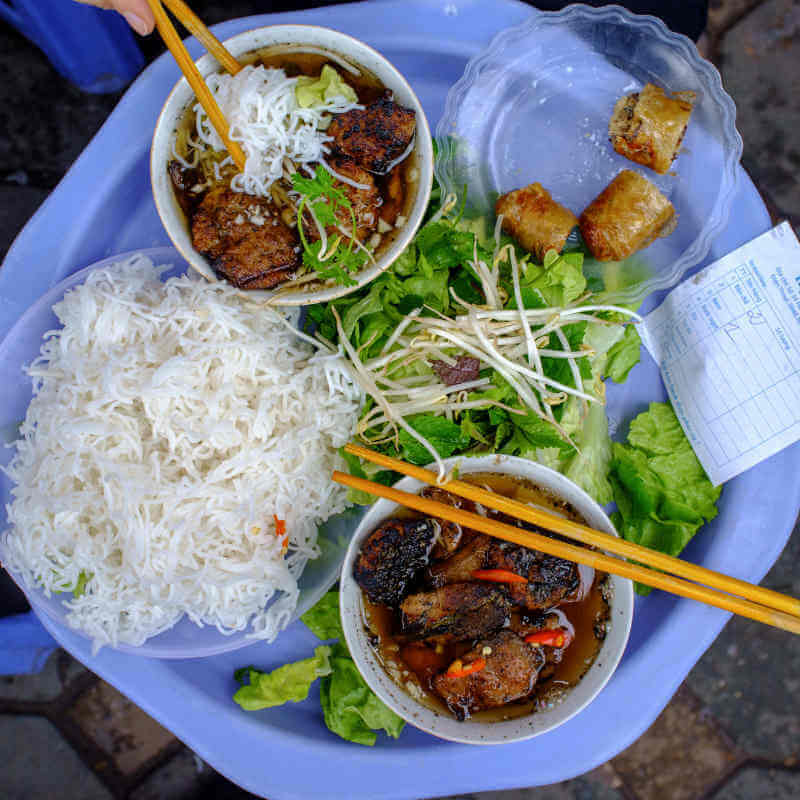 Visitors love to try Bun Cha, a dish that Anthony Bourdain shared with President Obama during his visit to Hanoi