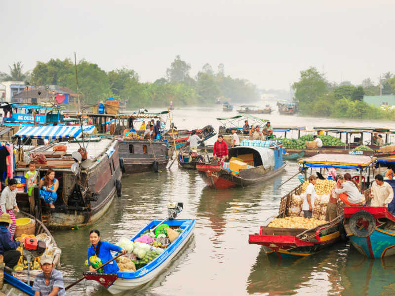 The floating market is a unique attraction of the Mekong Delta region. With a majority of the area are rivers and canals, trading by boats becomes a habit of the locals