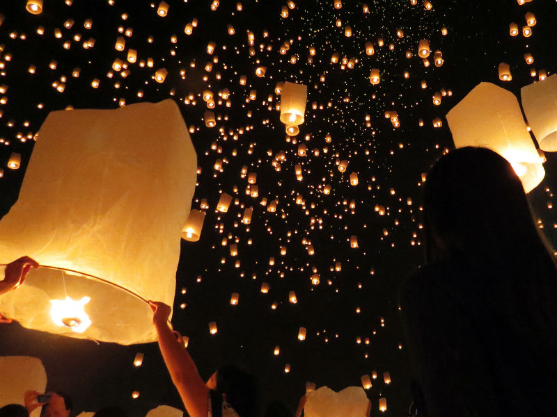 People held their lanterns firmly, whispered their wishes, and waited patiently for the heated air to completely inflate the lanterns...