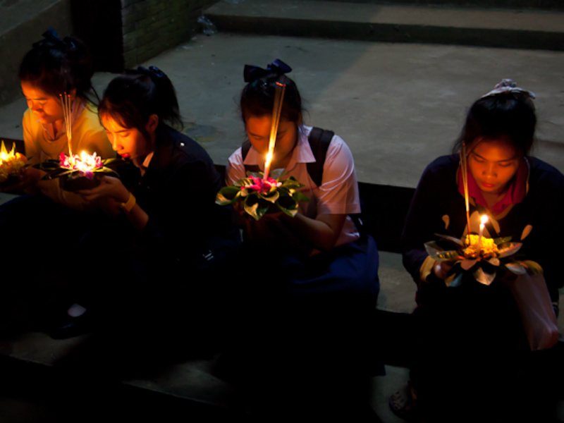 The girls were saying prayers before sending their candle-lit Krathongs into the Ping River