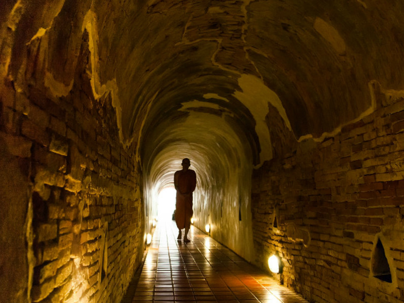 "The ancient brick tunnel in Wat Umong which Nhung said it was ""a place that brings peace to every mind"