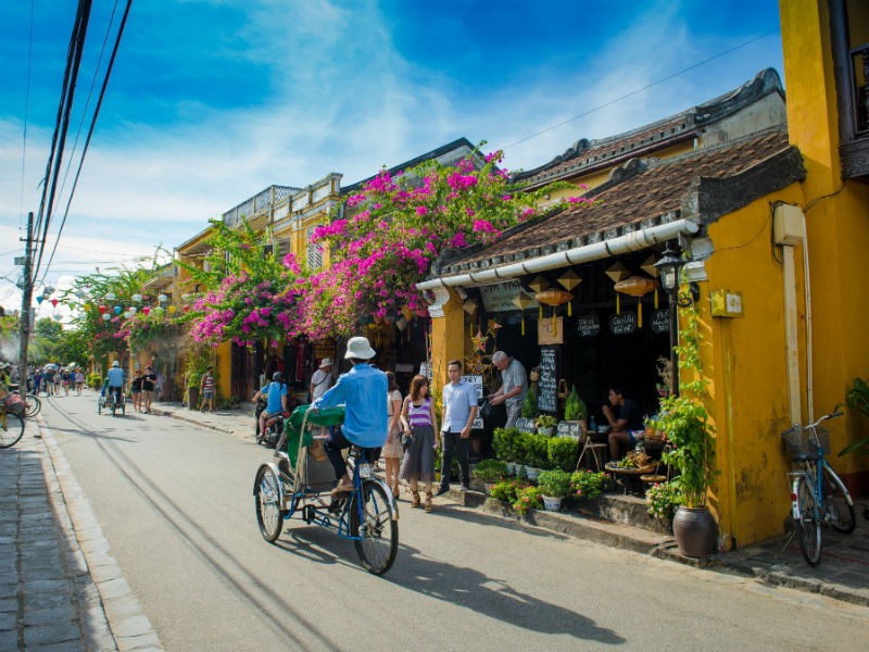 Hop on a trishaw to discover the little old town Hoi An