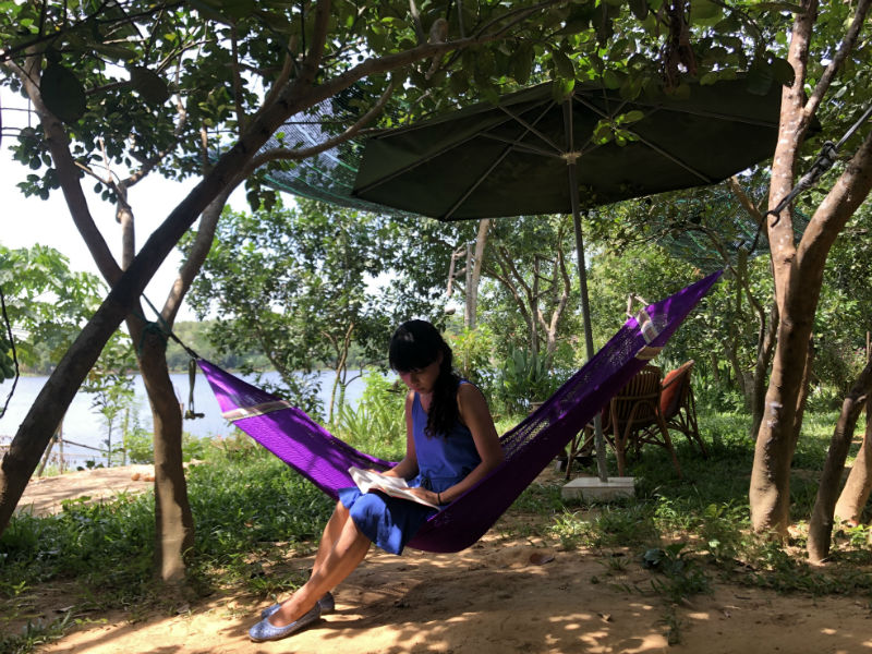 There is a hammock tied on trunks of two trees where you can rest while waiting for your lunch