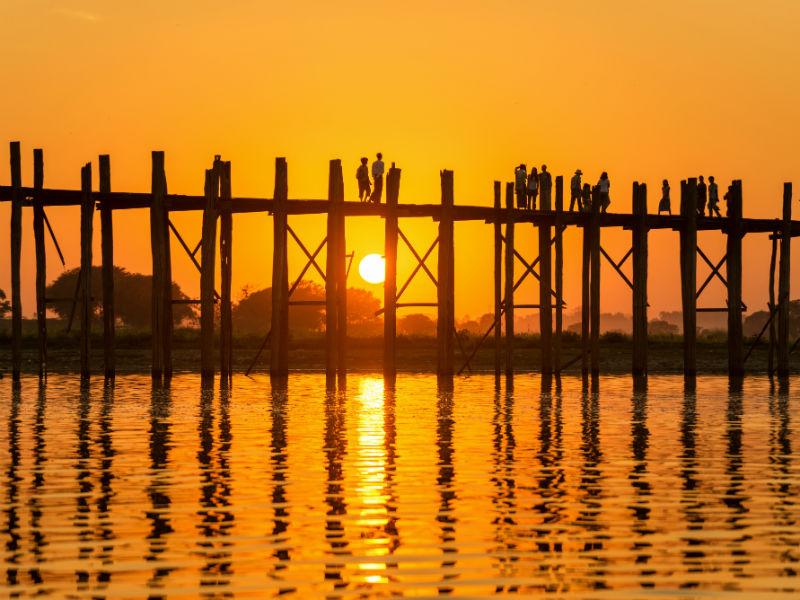 Stroll along an ancient bridge on the sunrise