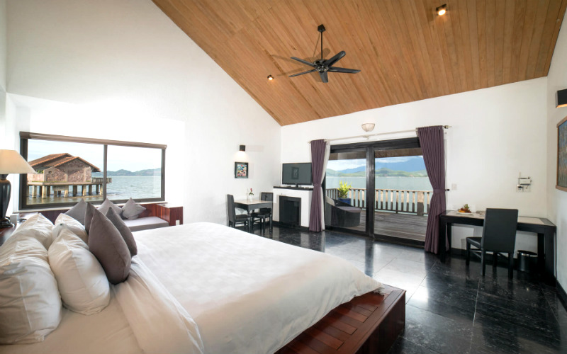 All rooms feature stylish interior decoration with thatched roofs, natural materials, and a private sundeck