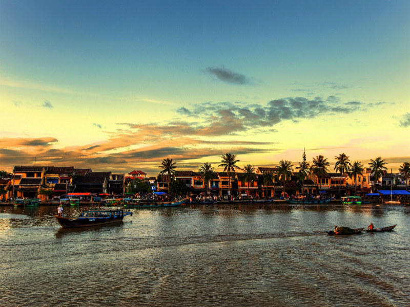 I drifted quietly downstream, watching fishing-boats, coconut palms, and iconic tiled roof houses along the water