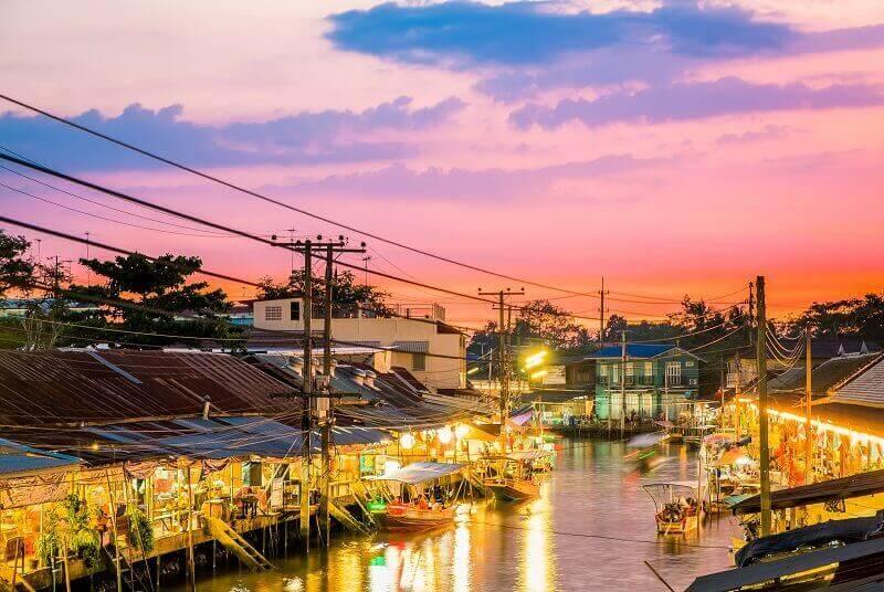 Floating market at night in Amphawa, Samut Songkhram Province, Thailand