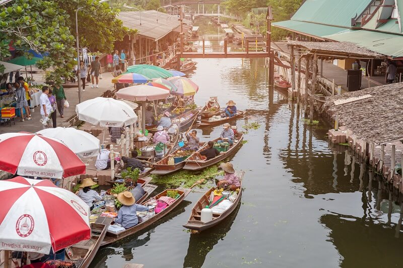 The atmosphere of trading goods and food, on vintage boats at Tha Kha Floating Market, Samut Songkhram, Thailand